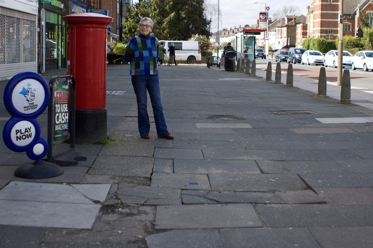 Carol O'Toole standing on cracked pavement at Shooters Hill shoppers parade